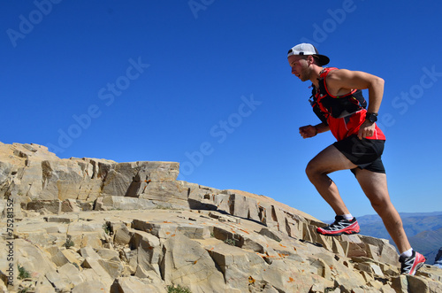 Fotografie, Obraz  Man running on a high mountain trail