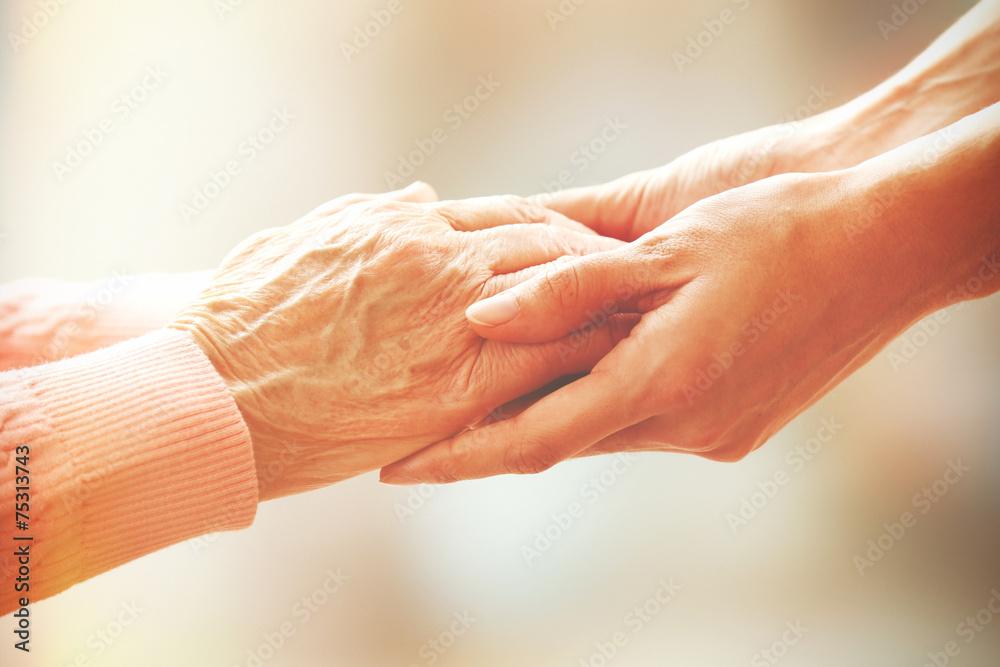Fototapeta Helping hands, care for the elderly concept