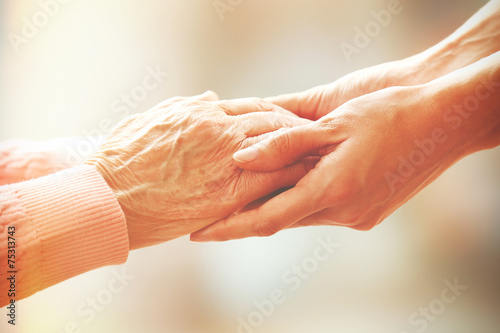 Láminas  Helping hands, care for the elderly concept