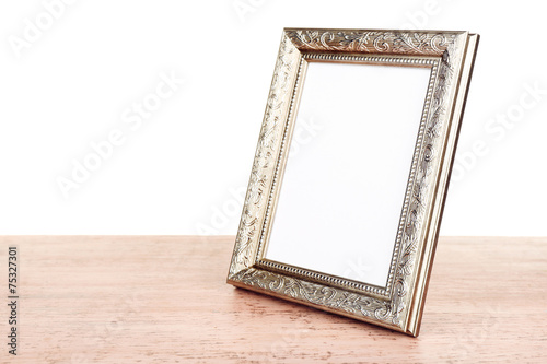Photo frame on wooden table isolated on white - Buy this stock photo ...