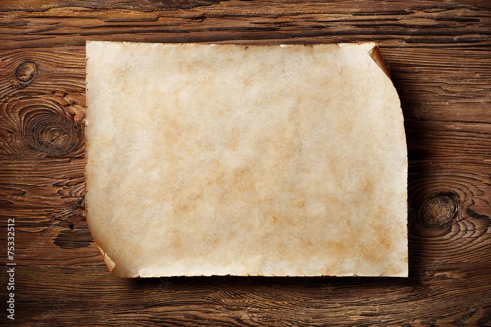 Fototapeta old parchment on aged wood, horizontal