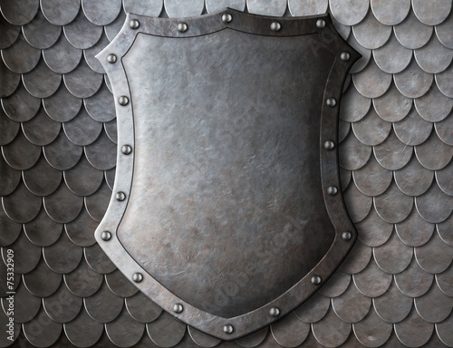 Photo  old medieval coat of arms shield over scales armour background