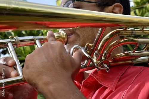 Poster South America Country Trombonist is exercised by the trombone.