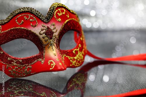 Vintage carnival mask in front of champagne glasses