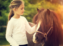 Small Child And Pony