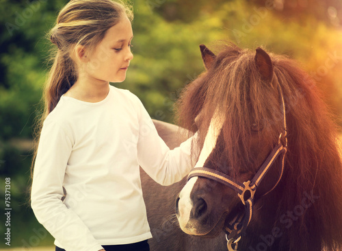 Fotografie, Obraz small child and pony