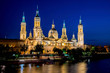 Our Lady of the Pillar Basilica with Ebro River at dusk Zaragoza