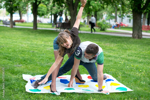 Fotografie, Obraz  Students play a game in the park twister