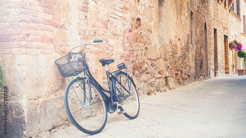 Aluminium Prints Bicycle Black vintage bicycle left on a street in Tuscany, Italy