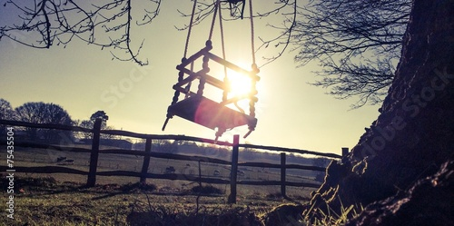 child's swing in sunny winter