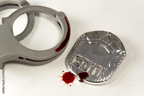 Fényképezés  Bloody Badge and Handcuffs