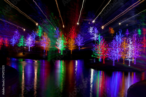 Abstract of trees tightly wrapped in LED lights for the Christma Canvas-taulu