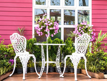 Vintage Garden With White Tea Table And Chairs