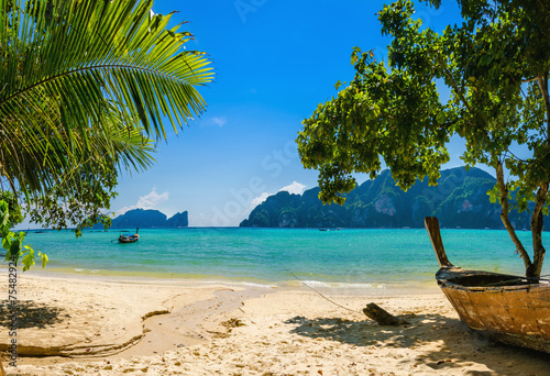 Exotic beach with palms and boats on azure water, Phi Phi Island Canvas Print