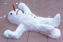 Funny Snowman Lying On The Gro...
