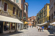 street in historic Venice, Italy with beautiful monument