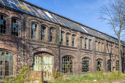 Foto op Plexiglas Oude verlaten gebouwen Destroyed, the historic factory hall