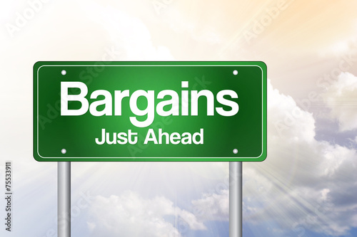 Photo  Bargains Just Ahead Green Road Sign concept