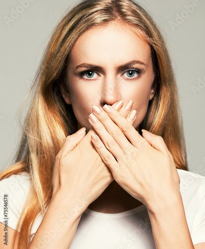 Woman with closed mouth Canvas Print