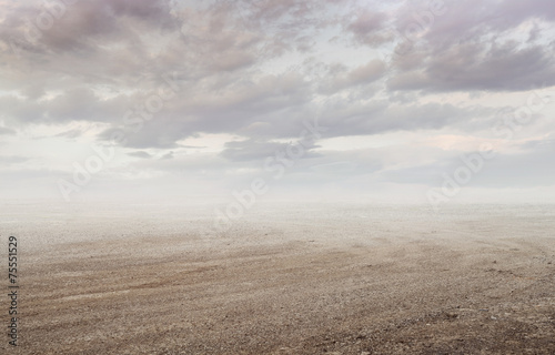 Gravel background with gravel mist and clouds in sunset Fototapeta