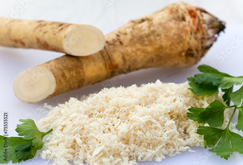 Fotografie, Obraz  Fresh horseradish with parsley leaves