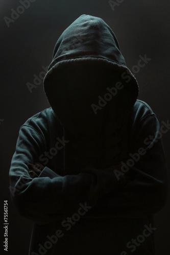 Fényképezés  Unrecognizable person wearing hood against black background