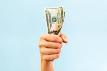 A Hand Holding A Handful Of Twenty Us Dollars.