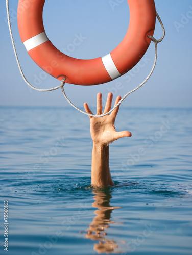 Lifebuoy for drowning man in sea or ocean water. Insurance Fototapeta