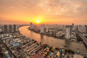 The beautiful sunset over Chao Phraya river of Bangkok the capital cities of Thailand.