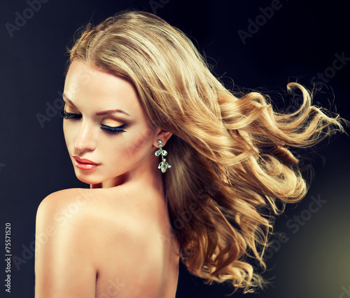 Fotografie, Tablou Beautiful model blond with curly hair and fashion earings