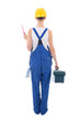 back view of young beautiful woman builder in workwear with tool