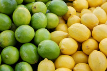 Pile Of Fresh Yellow Lemons An...