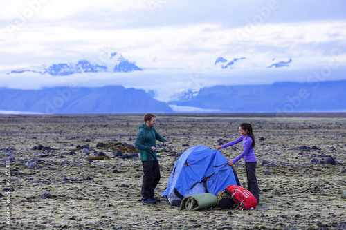 Fotografie, Obraz  Camping couple pitching tent after hiking