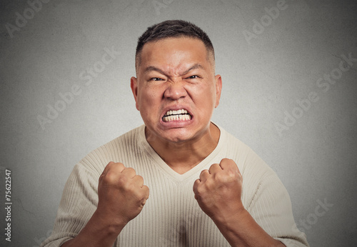 Valokuva  headshot angry man with open mouth fist up in air screaming