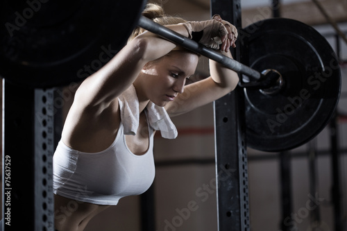 Fotografie, Obraz  Tired girl after weight lifting