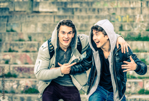 Valokuva  Young hipster brothers having fun with each other - Best friends