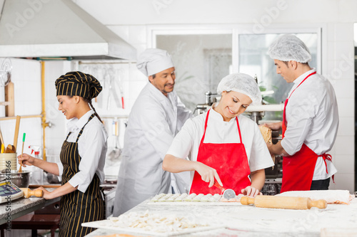 Photo  Chefs Preparing Pasta In Kitchen