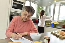 Elderly Woman Doing Crosswords...