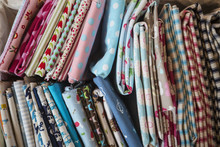 Selection Of Colourful Sewing Fabrics.