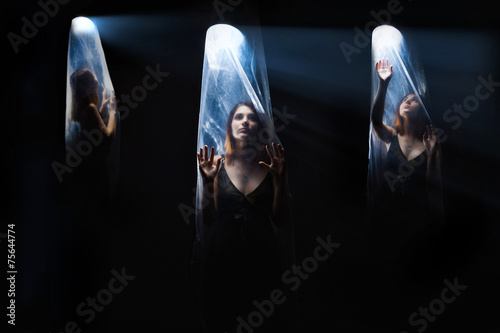 agoraphobia 3 girls woman inside a plastic bag,  bright light Wallpaper Mural