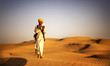 Leinwanddruck Bild - Indigenous Indian Man Playing Wind Pipe Desert Concept