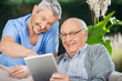 canvas print picture - Nurse And Senior Man Enjoying While Using Tablet Computer