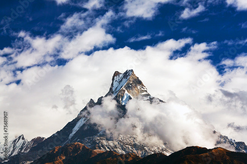 Wall Murals Nepal Holy mount Machapuchare over clouds, Nepal