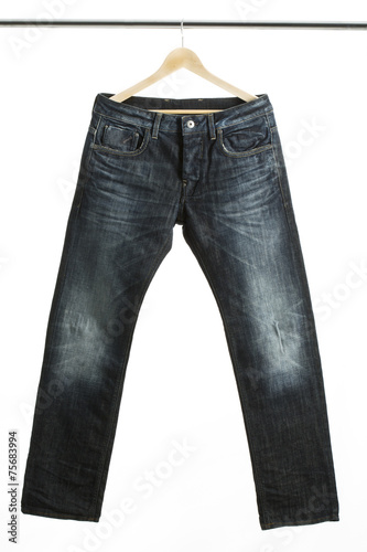 Fotografie, Obraz  Jeans auf einem Kleiderbügel