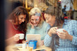canvas print picture - Group Of Female Friends In Caf' Using Digital Devices
