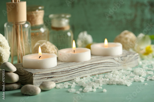 Keuken foto achterwand Spa Composition of spa treatment, candles in bowl with water
