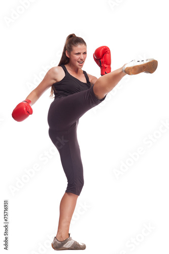 Fotomural  sport young woman with red gloves going to fighting