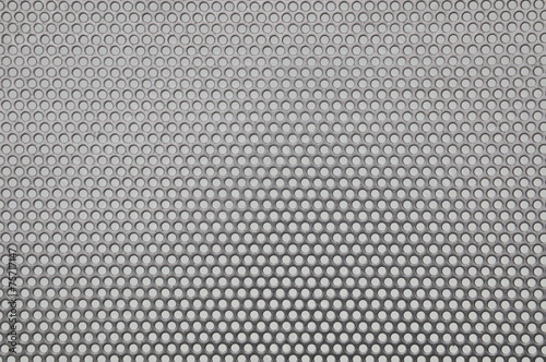 Valokuva  Metal surface with holes, industrial background