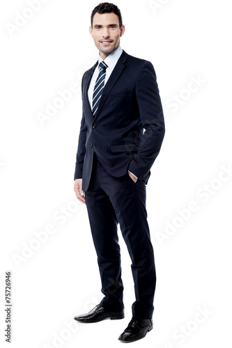 Photo  Handsome entrepreneur posing over white