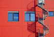 canvas print picture - rote Fassade mit Wendeltreppe